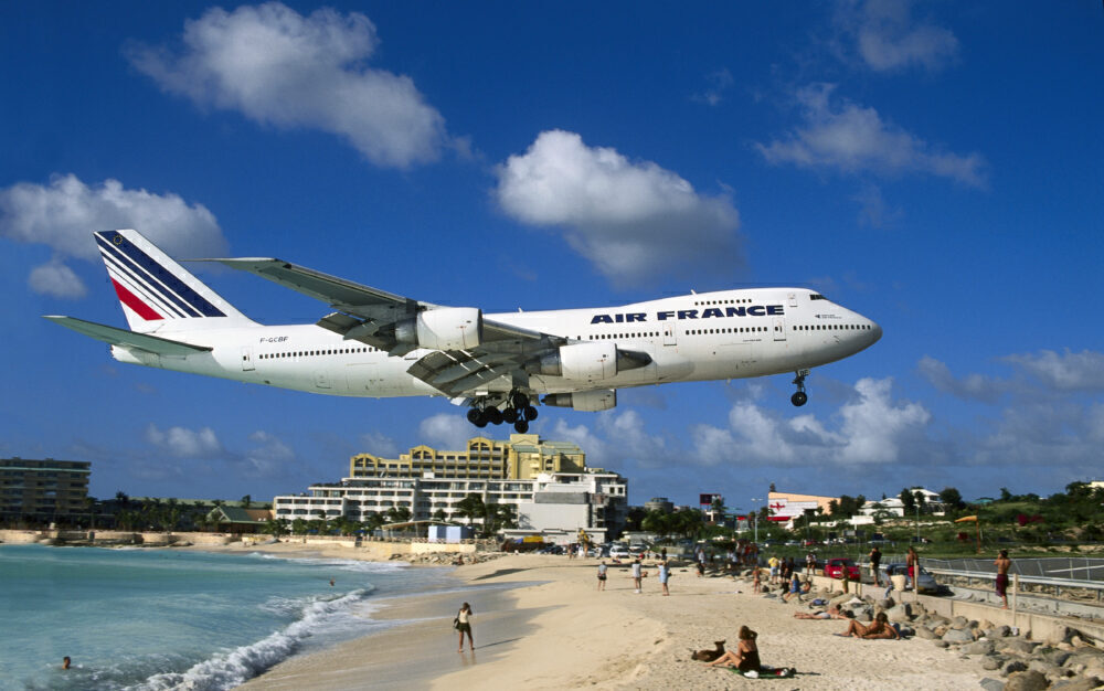 Air France Boeing 747-200M on very low final-approach over Maho Beach with hotels behind